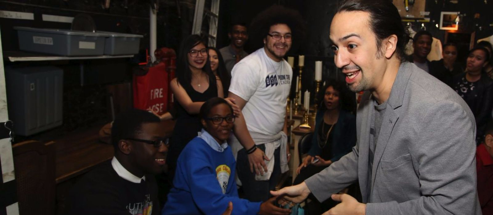 Teenagers meeting entertainer Lin-Manuel Miranda backstage