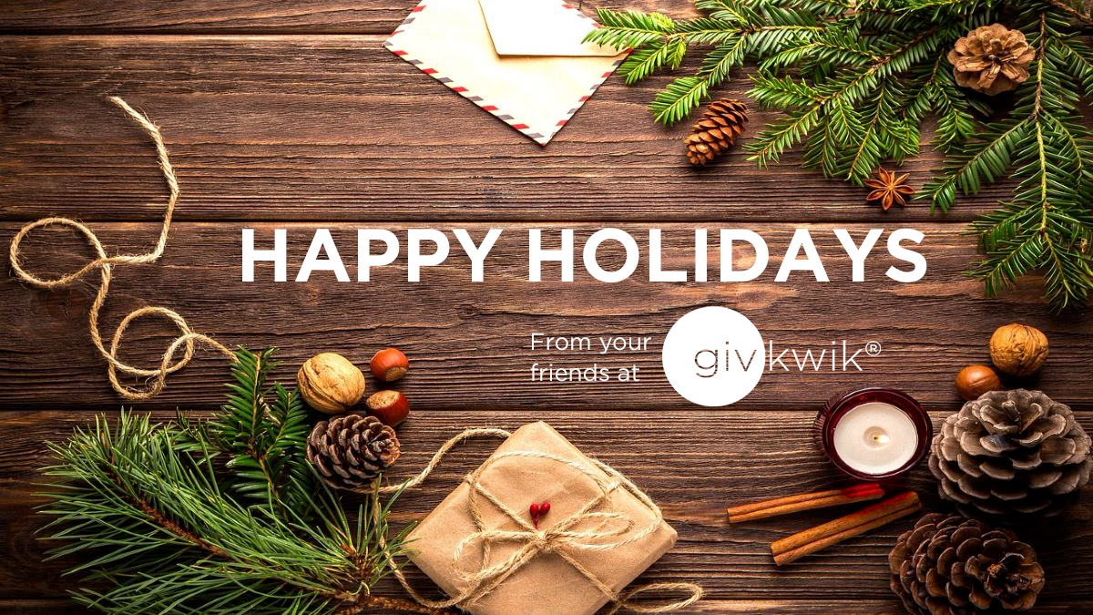 Photo of pine cones, cinnamon, and candles on top of a wooden table with the words Happy Holidays from your friends at Givkwik.